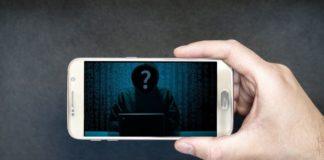 Imagen de teléfono con imagen de la silueta de un hacker